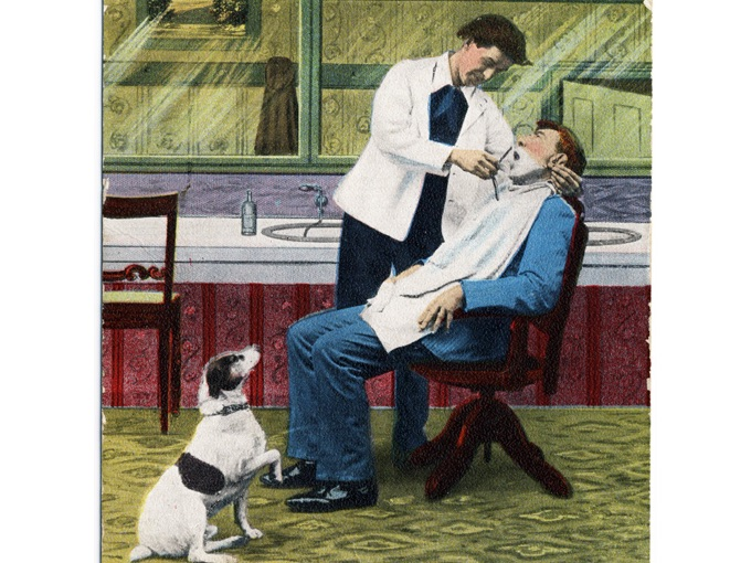 1911 Photo Post Card — Barber Shaving a Man with Dog Looking On
