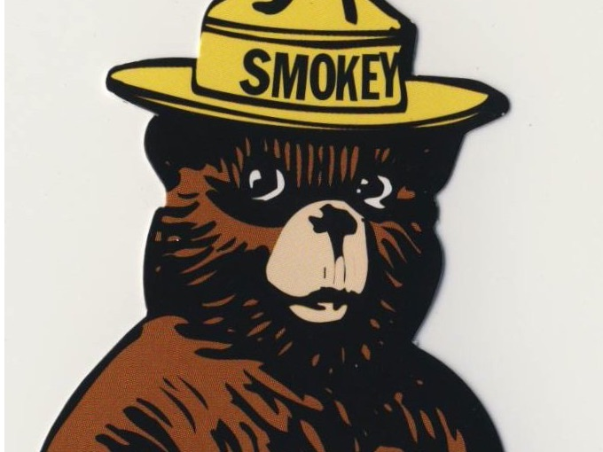 Die-cut of Smokey Leaning on a shovel